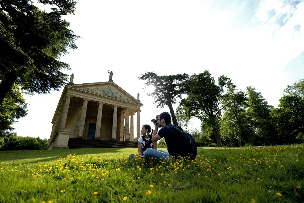 Couple taking aphoto in front of the Temple of Concord and Victory (C) National Trust Images John Millar