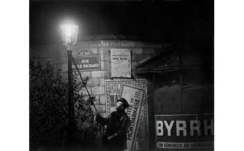 Brassaï. Extinguishing a Streetlight, rue Émile Richard. c. 1932 © Estate Brassaï Succession, Paris.